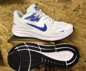 White Nike Zoom sports shoes